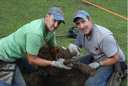 "Photo courtesy of National Geographic Channel""King"" George Wyant and Tim ""Ringy"" Saylor, of the National Geographic show ""Diggers,"" clean off artifacts uncovered at the McCoy well at Bob Scott's property in Hardy."