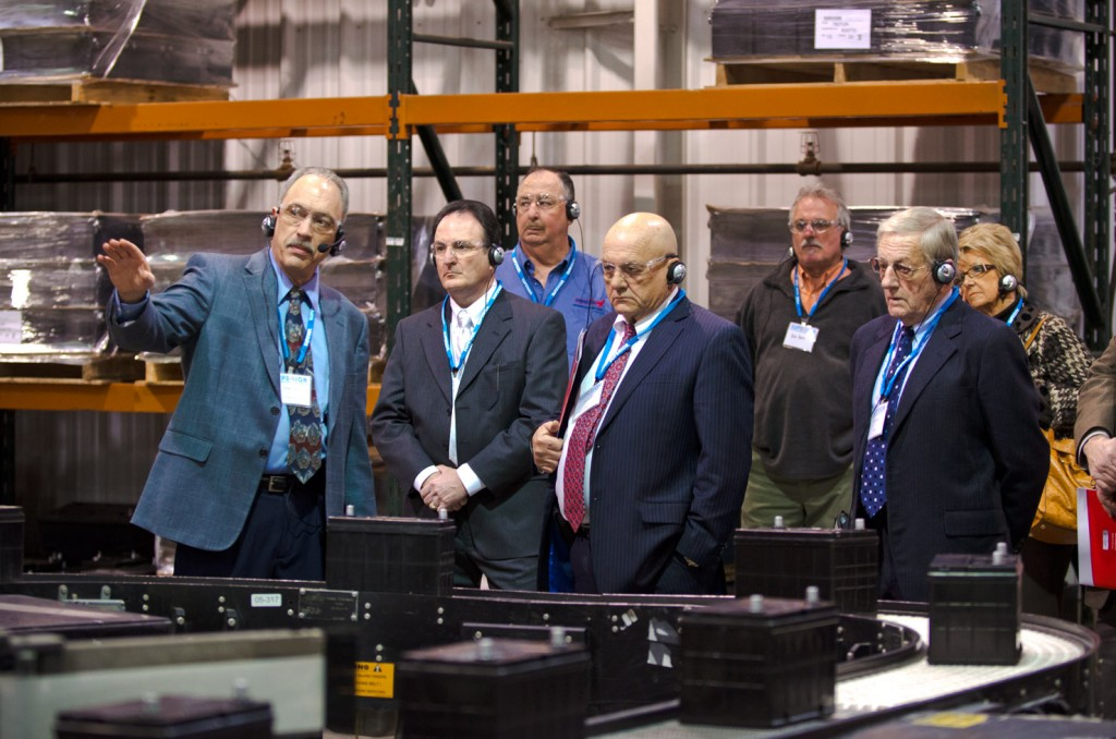 The invitation-only event included a tour of Superior Battery's manufacturing facility. At right, CEO Randy Hart introduces the group to the plant's newest line, which manufactures batteries with PFX Technology.