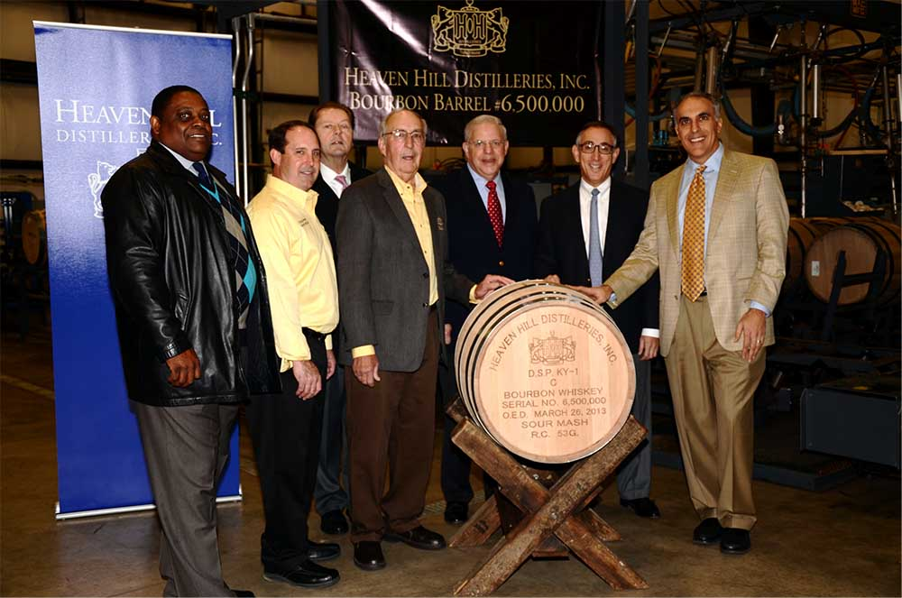 Heaven Hill Distilleries, Inc. executives and local dignitaries commemorate the filling of barrel number 6,500,000. From left are: Bardstown Mayor Bill Sheckles, Heaven Hill Master Distiller Craig Beam, Nelson County Judge Executive Dean Watts, Heaven Hill Master Distiller Parker Beam, Heaven Hill Distilleries Executive Vice President Harry J. Shapira, Heaven Hill Distilleries President Max L. Shapira, and Heaven Hill Distilleries COO Allan Latts.