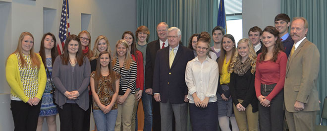 """U.S. Congressman Harold """"Hal"""" Rogers, R-Ky., University of Louisville President Dr. James R. Ramsey and Lonnie Lawson, president and CEO of The Center for Rural Development, join graduates of the Rogers Scholars youth leadership program for a group photo following a press conference at The Center in Somerset. Ramsey was at The Center to announce the University of Louisville is offering exclusive scholarship opportunities for graduates of the Rogers Scholars program."""