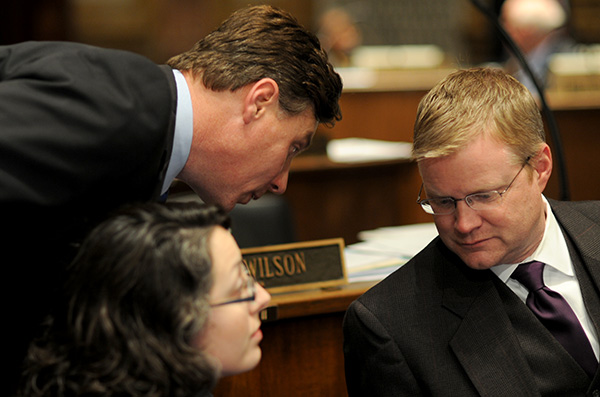 Senate Majority Whip Brandon Smith, R-Hazard, left, confers with Senate Majority Floor Leader Damon Thayer, R-Georgetown, as Sen. Sara Beth Gregory, R-Monticello, looks on.