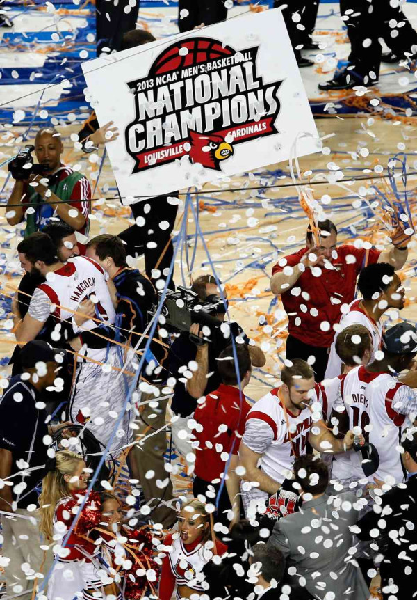 The Louisville Cardinals celebrate their new title Monday night, 2013 NCAA Champions.