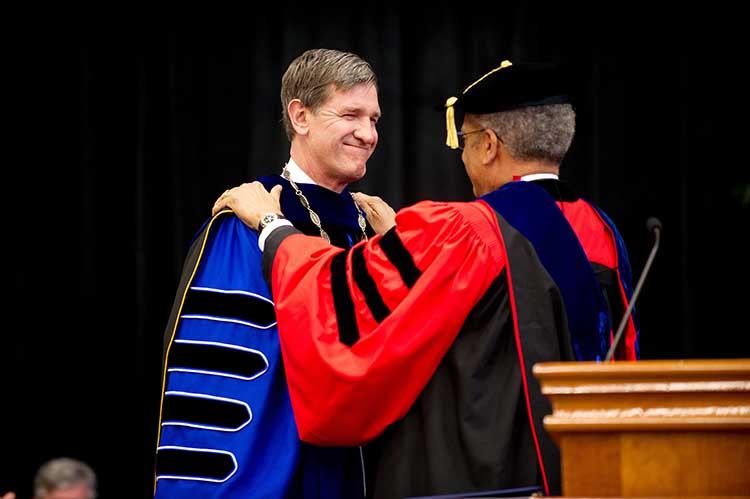 Lyle Roelofs is installed as Berea College's ninth president Saturday, April 6. Dr. Eugene Y. Lowe, executive committee member of the board of trustees, presided over the ceremony.