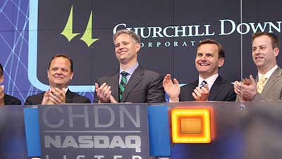 From left are UofL Board of Trustees members Chester Porter and Frank Minnifield; Robert L. Evans, chairman and CEO of Churchill Downs Inc.; and Brian F. Lavin, president and CEO of NTS Realty Holdings.