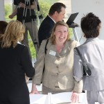 Colleen Chaney, field representative for U.S. Rep. Andy Barr, R-Ky., shares a laugh Thursday with friends after the ribbon-cutting ceremony at the global services center of Bingham McCutchen.