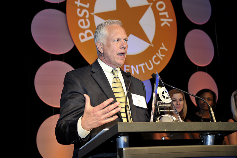 John Eckman, senior vice president of human resources for Trilogy, accepts the company's award at the 2013 Best Places to Work in Kentucky awards dinner.