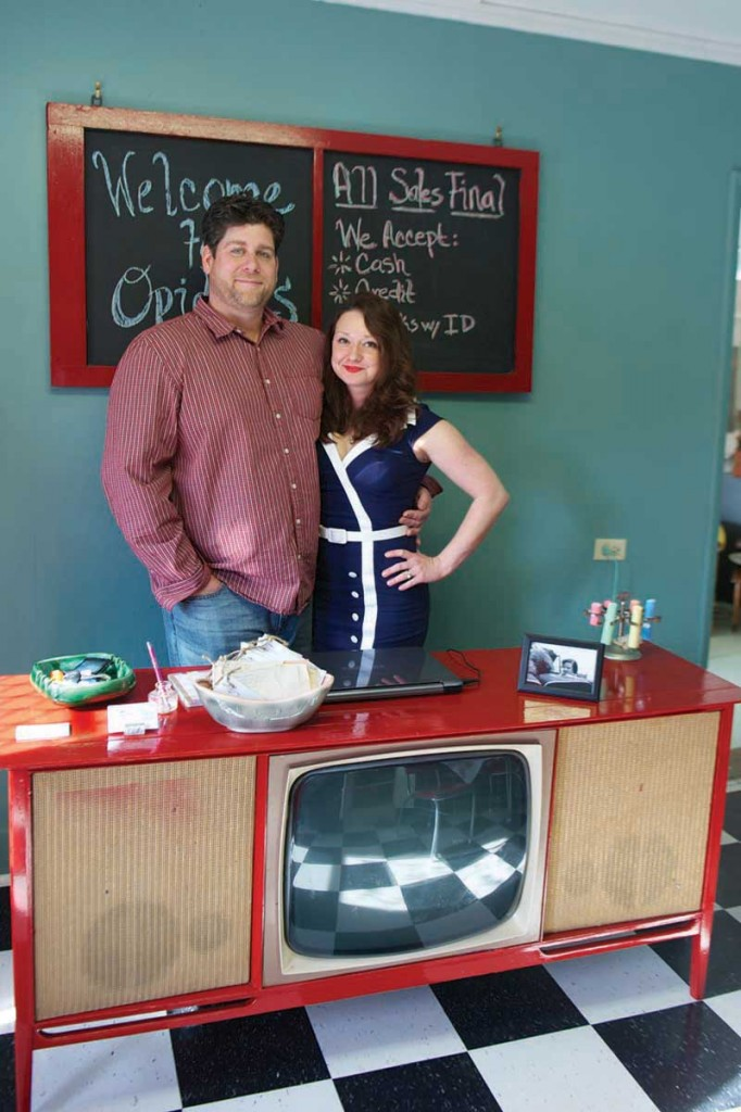 """Newlyweds Chad and Jill Walker opened Opidell's, a vintage and antique store on National Avenue, in part because many of Chad's belongings were """"kicked to the curb"""" to make room for Jill's antiques collection."""
