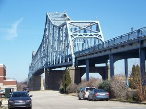 The Blue Bridge is 4,622 feet long. It connects KY 2262 and Indiana State Route 161 over the Ohio River at Owensboro.