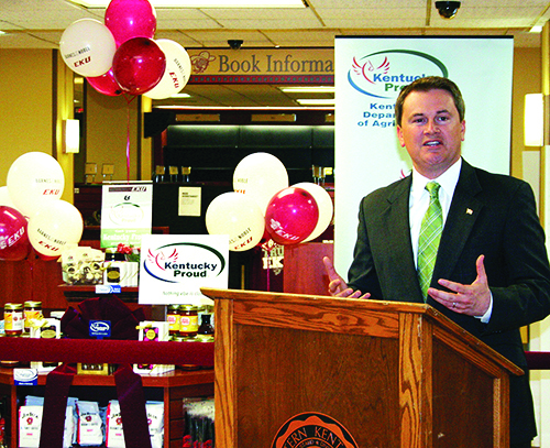 Agriculture Commissioner James Comer talks about the Kentucky Proud Farm to Campus Program in front of a Kentucky Proud display at the Eastern Kentucky University bookstore in Richmond. (Kentucky Department of Agriculture photo by Chris Aldridge)