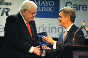Mayo Clinic Southeast Medical Director Stephen Lange, M.D. (right) presents a special award to Pikeville Medical Center President and CEO Walter May at the press conference announcing that PMC would be joining the Mayo Clinic Care Network. (Photo courtesy of Pikeville Medical Center)
