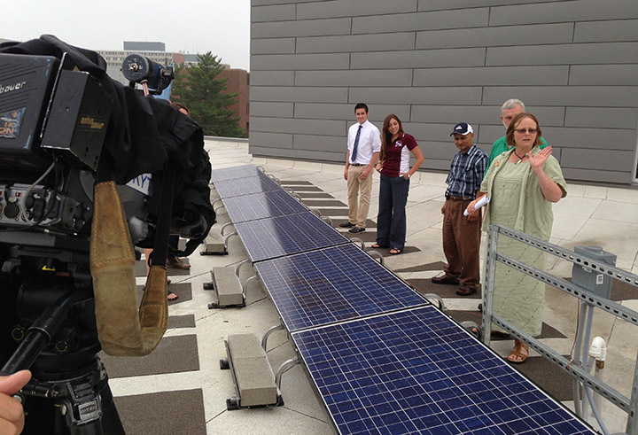 Dr. Alice Jones, right, director of EKU's Office of Sustainability, explains the solar panel array atop EKU's New Science Building.