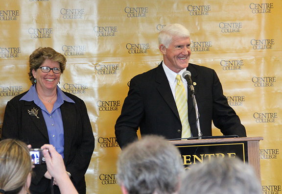 Centre College President John A. Roush is all smiles as he announces that the college has received a gift of $250 million to establish a scholarship program. At left is Stephanie Fabritius, vice president for academic affairs and dean of the college.