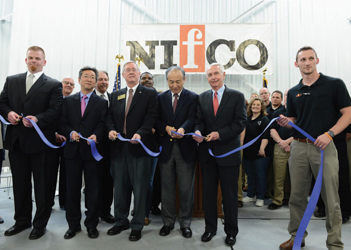 Nifco America Corp. officials, along with Gov. Steve Beshear, cut the ribbon on the Japanese-company's expanded operations in Shelbyville. The automotive supplier has invested more than $4.3 million to purchase new, state-of-the-art injection molding equipment and has spent $3 million to add 73,000 s.f. to its existing 115,000-square-foot facility, creating 100 new jobs.