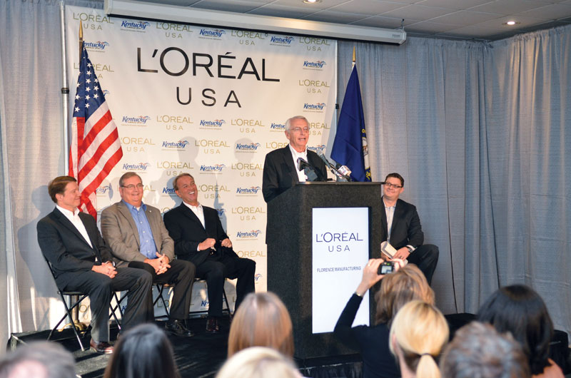 Gov. Steve Beshear, flanked by company and local officials, announces that global cosmetics and hair care manufacturer L'Oréal USA will expand its operations in Northern Kentucky, investing $42 million and adding 211 jobs.