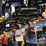 Workers at Ford's Louisville Assembly Plant assemble the all-new Escape after an employee celebration last year to mark the $600 million transformation of the facility. (Sam VarnHagen/Ford Motor Co.)