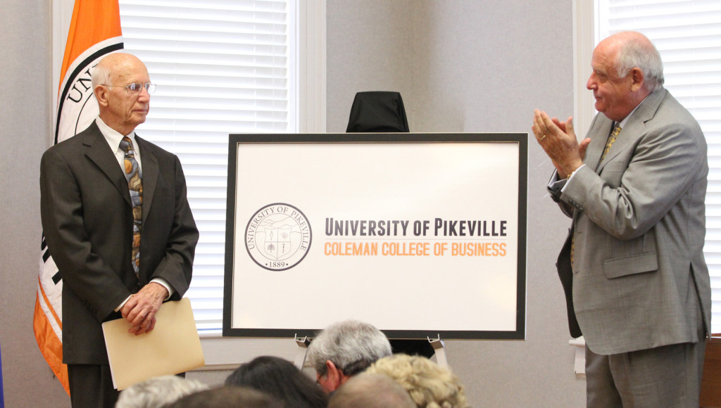 University of Pikeville Board Chairman Terry Dotson, right, unveils the name of the university's new business school. It was named for Burlin Coleman, left.