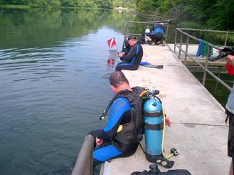 Divers prepare to enter the water at the scuba refuge at Greenbo Lake.