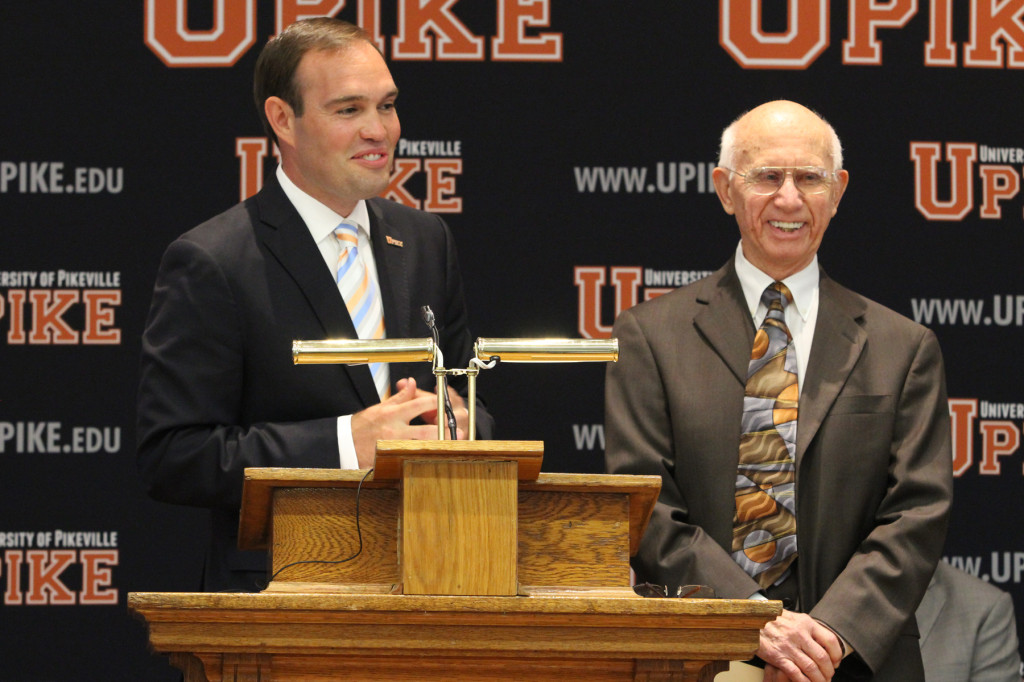 University of Pikeville President Dr. James Hurley, left, announces the creation of the Burlin Coleman College of Business. Coleman is shown at right.