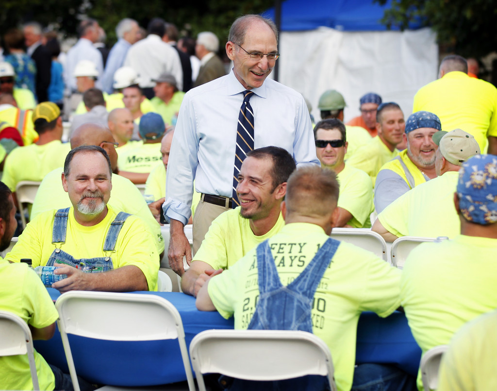 UK President Eli Capilouto chats with construction workers at the appreciation breakfast on Monday morning.