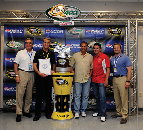 Lt. Gov. Jerry Abramson, from left, brought a state proclamation declaring NASCAR Week to the Quaker State 400. With him are Kentucky Speedway general manager Mark Simendinger, University of Kentucky basketball coach John Calipari, Papa Johns Pizza founder John Schnatter and Speedway Motorsports President Marcus Smith.