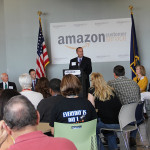 State Sen. R.J. Palmer, D-Winchester, speaks to the crowd gathered to celebrate Amazon's grand opening in Winchester.
