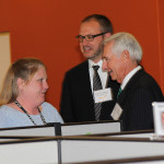 Tom Weiland, Amazon vice president of global customer service, and Gov. Steve Beshear talk with Janet Reed, an employee of the Winchester call center.
