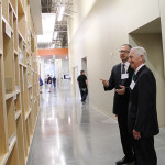 Tom Weiland, Amazon vice president of global customer service, gives Gov. Steve Beshear a tour of the Winchester call center. The two are looking at a wall that depicts Amazon's history.