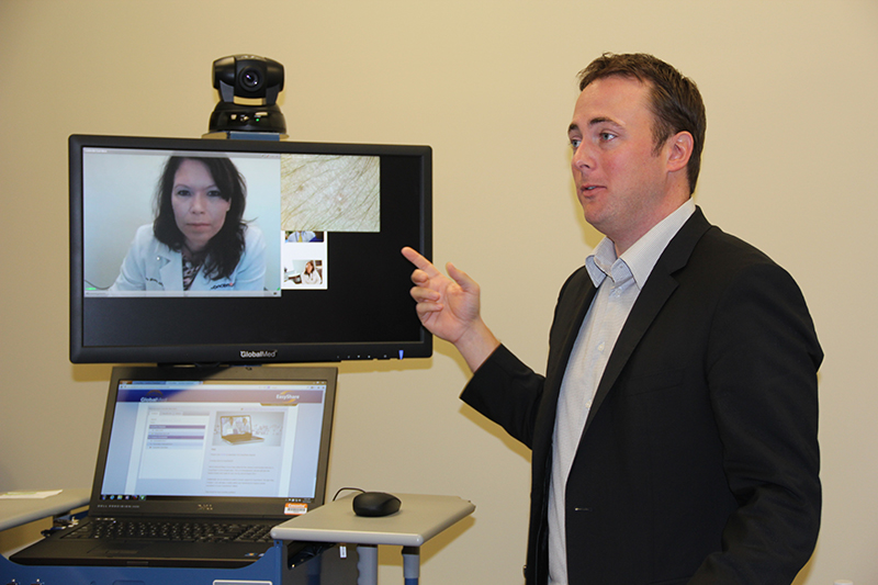 Kevin Borowicz, director of product management for Concentra, gives a tour of the new telemedicine suite at the Humana Health and Well-being Center at the company's headquarters in downtown Louisville. On the screen is nurse practitioner Diane Moore.