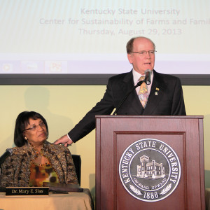 Alltech founder and CEO Dr. Pearse Lyons announces a sustainable farming alliance with Kentucky State University. At left is Dr. Mary Evan Sias, KSU president.