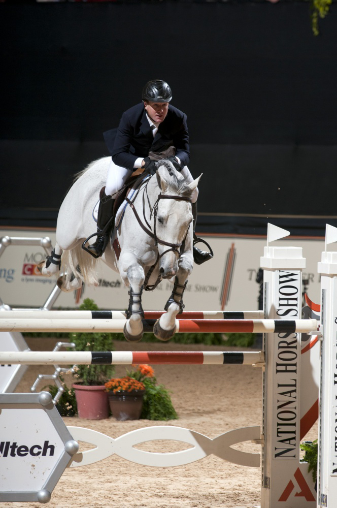 Two-time Olympic gold medalist McLain Ward jumps to victory in the $250,000 Alltech National Horse Show Grand Prix during the 2012 Alltech National Horse Show.
