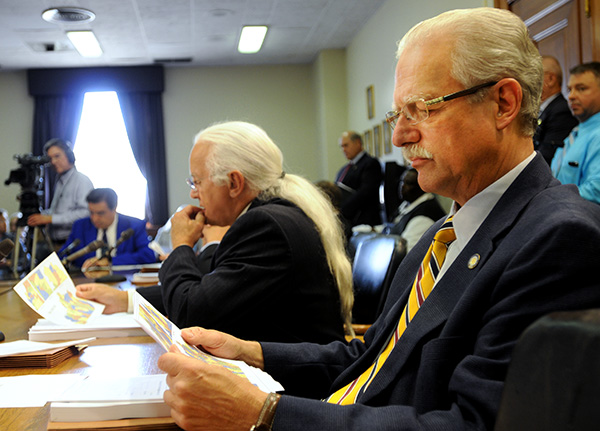 Sen. Ernie Harris, R-Crestwood, right, and Sen. Walter Blevins, D-Morehead, review maps Thursday showing proposed new legislative boundaries during a meeting of the Senate State Government Committee.