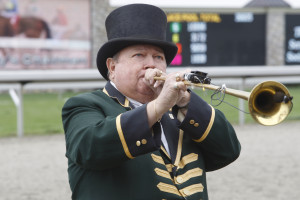 """George """"Bucky"""" Sallee, bugler at the historic race track for more than 50 years, will retire to become bugler emeritus beginning this fall."""