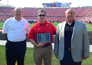 Bill Bell, director of the Kentucky Office of Highway Safety, center, presents John Seay, safety and technical training consultant, DOT compliance for LG&E and KU, left, and Ken Sheridan, director of operations and scurity for LG&E and KU, with the 2013 Outstanding Service Award for the company's commitment to reducing distracted driving crashes in Kentucky.
