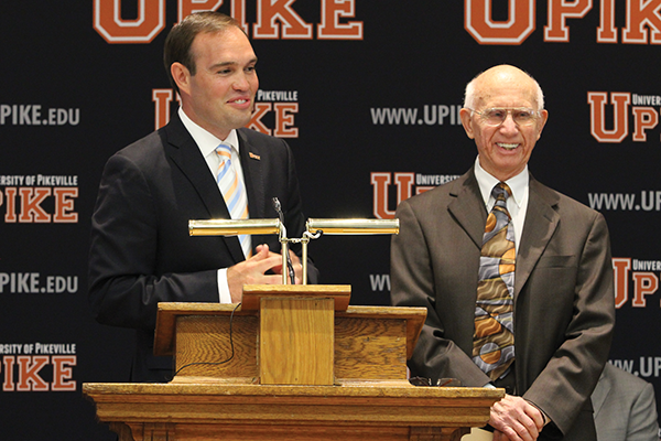 Dr. James Hurley, left, president of the University of Pikeville, announces that retired banker and longtime UPike supporter Burlin Coleman, right, donated $1 million for the launch of the school's new Coleman College of Business.