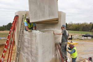 "Louisville sculptor Matt Weir (on ladder) made the final placement of stone to his ""Earth Measure"" sculpture honoring Barry Bingham Jr."