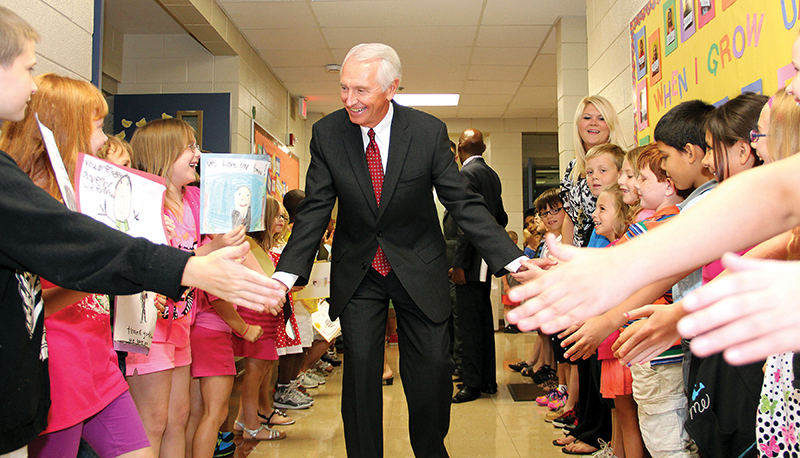 "Gov. Steve Beshear greets Simpsonsville Elementary School students during an August 2013 visit to announce $41 million in ""Race to the Top"" grant funding to Kentucky school district co-ops."