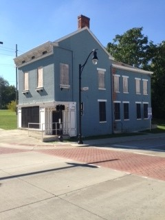 Tract 1: A 2½-story brick house built about 1910, known as the Flannery Building. It is 2,466 S.f.