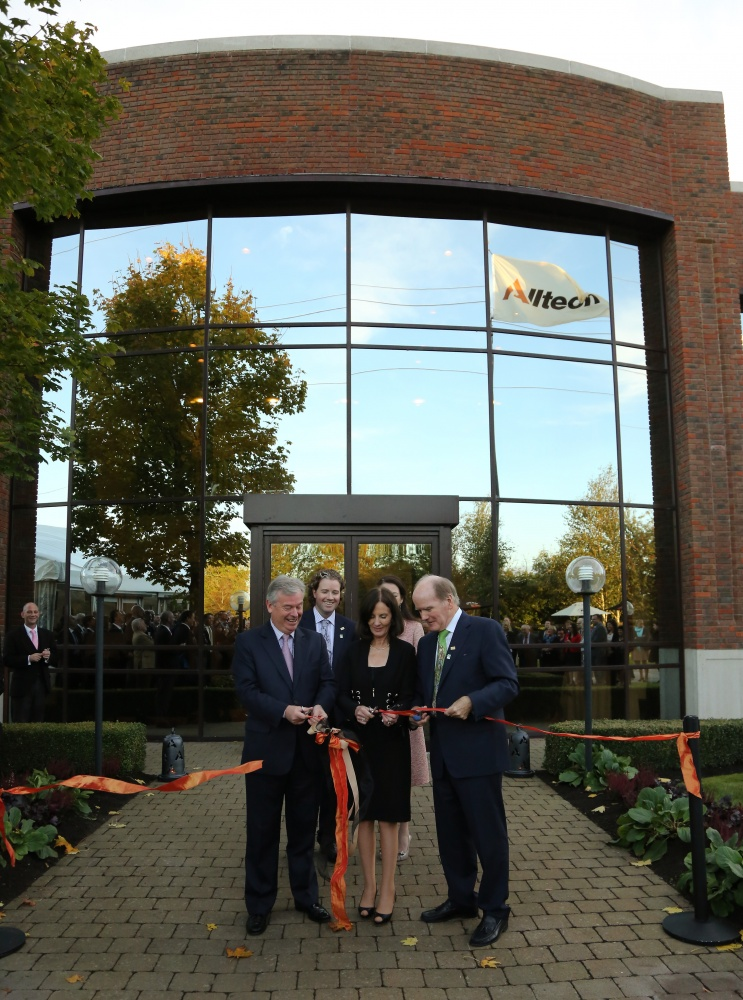 From left, David Byrne, former EU Commissioner for Food Safety, joins Deirdre Lyons, Alltech's co-founder and director of corporate image and design, and Dr. Pearse Lyons, president and founder of Alltech, to cut the ribbon at the grand opening of Alltech's newly expanded European headquarters.