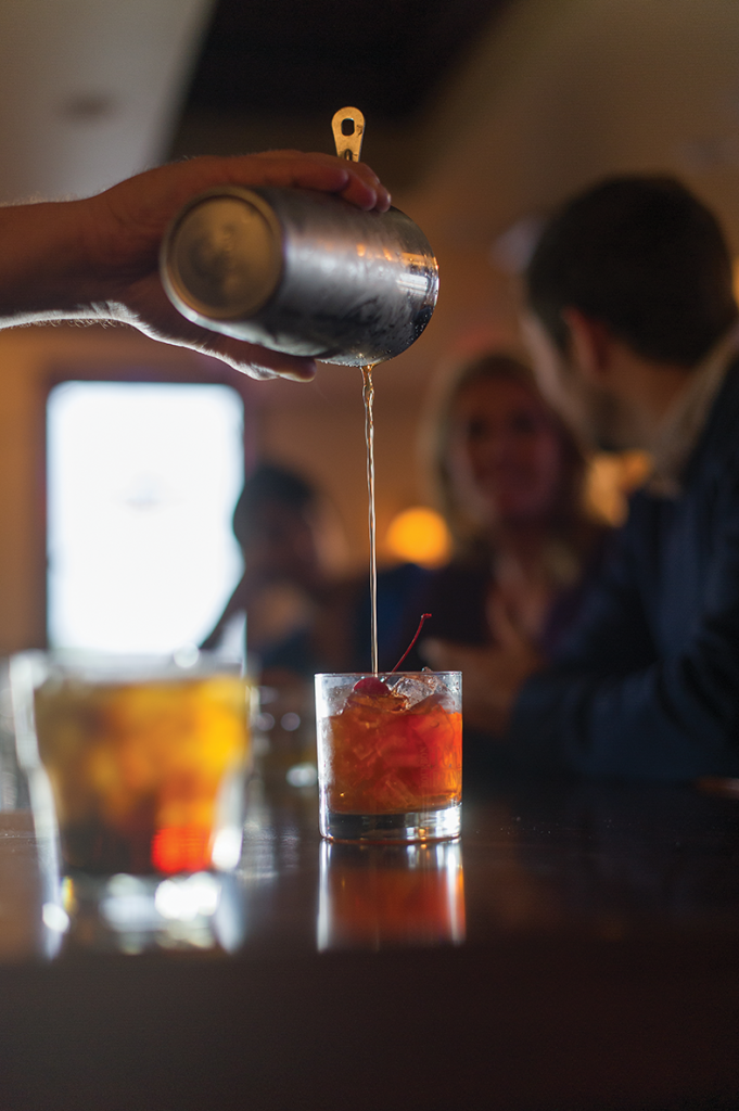 A bourbon mixed-drink is poured at Jefferson Davis Inn in Lexington. (Photo by Shaun Ring)
