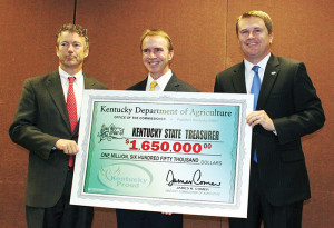 From left, U.S. Sen. Rand Paul, R-Ky., Kentucky State Treasurer Todd Hollenbach and Agriculture Commissioner James Comer with the commemorative check. (Kentucky Department of Agriculture photo)