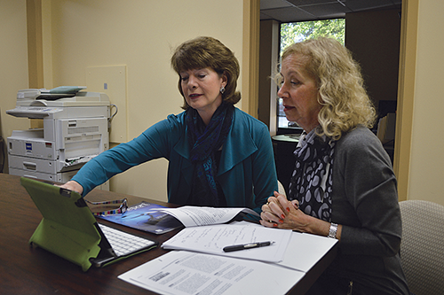 Marcia Roth, executive director of the Mary Byron Project, and Madeline Abramson, chair of the Kentucky Commission on the Women, look at the domestic violence resources available to businesses at workplacerespond.org.