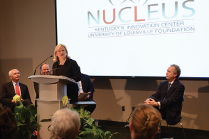 Vicki Yates Brown, president and CEO of Nucleus, spoke at the Oct. 23 opening of The Nucleus, the first of four planned research, technology and office buildings. Attending the opening were (from left) Gov. Steve Beshear, University of Louisville President James Ramsey and Louisville Mayor Greg Fischer.