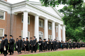 Students on the way to graduation ceremonies at Centre College in Danville walk past Old Centre, built in 1820. Today's students and administrators benefit from the returns on investments the school's endowment fund made decades ago.