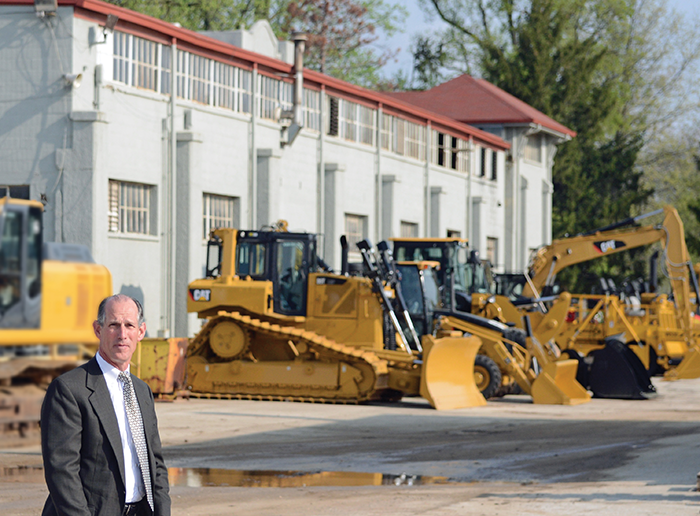 CEO Monty Boyd is pictured with a sampling of Caterpillar's current machine line.