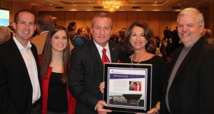 The late R.J. Corman's family was present at the annual National Philanthropy Day luncheon to accept the honor in his memory. Pictured left to right are son-in-law and daughter Korey and April Corman Colyer, Saint Joseph Hospital Foundation President and CEO Barry A. Stumbo, sister and brother-in-lawSandy and Jerry Adams.