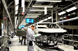 Workers at the Volkswagen manufacturing facility in Chattanooga conduct a quality check in the paint shop on a Passat.