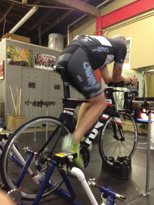 An indoor training aid for cyclists simulates outdoor routes while monitoring activity and progress.