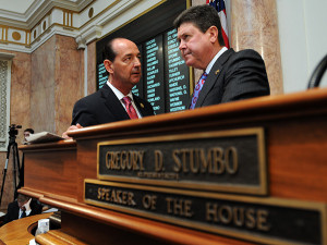 House Majority Floor Leader Rocky Adkins, D-Sandy Hook (left), speaks with House Speaker Greg Stumbo, D-Prestonsburg, on the floor of the Kentucky House of Representatives prior to the start of the opening day of the 2014 Regular Session of the Kentucky General Assembly.