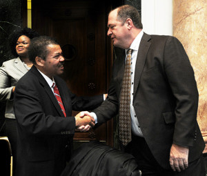 — House Republican Floor Leader Jeff Hoover, R-Jamestown (right), congratulates Rep. Jesse Crenshaw, D-Lexington, after passage of a bill sponsored by Crenshaw to put forth a constitutional amendment that would restore voting rights to some felons.