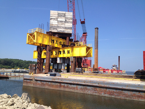 The construction of a three span (580 foot long) steel girder bridge (Lagoon Bridge) west of the proposed is progressing. The foundations for each of the substructure units are being constructed starting with the piling. Piling are steel beams or steel pipes that are driven into the soil to provide support to the bridge.